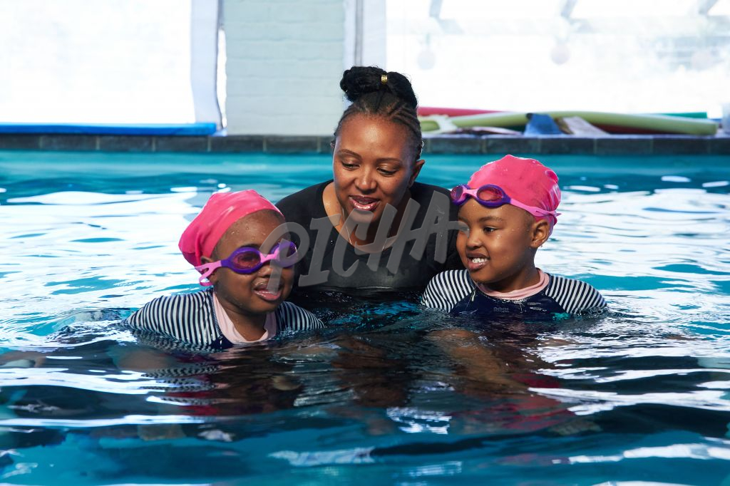 Lady in a pool with two children