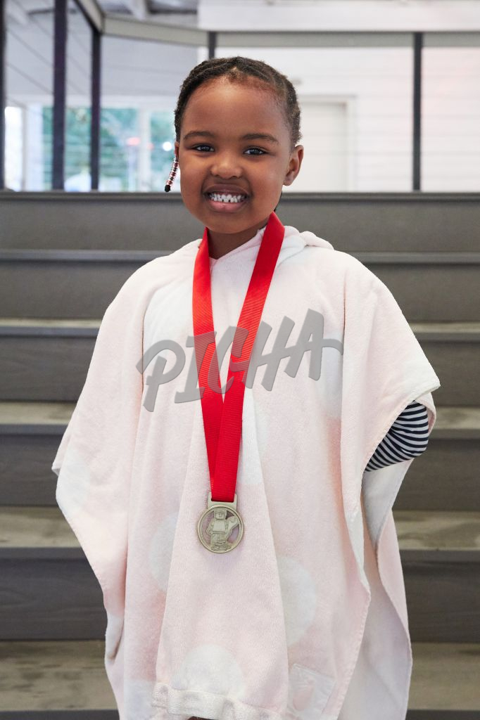 Young girl poses with swimming gown