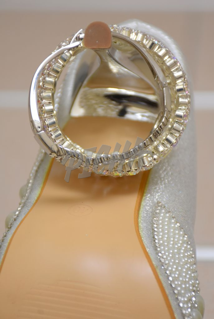close-up of bridal shoe and accessories