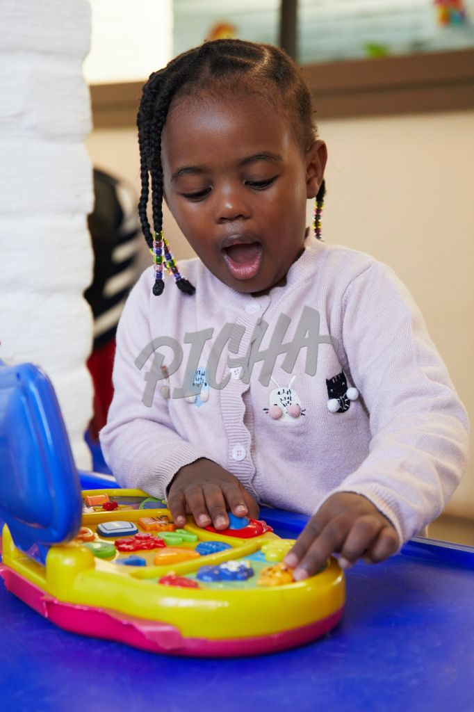 Young girl amazed by colourful toy