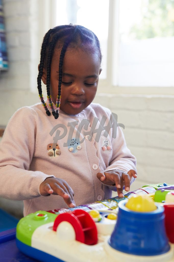 Close up of young girl playing with toy