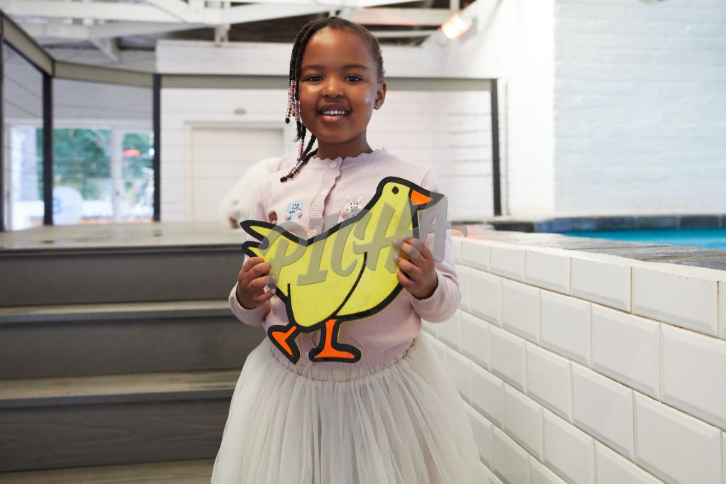 Young girl holding chicken printout
