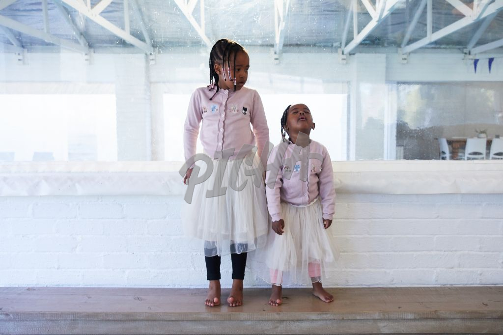Young girls in pink tulle skirts