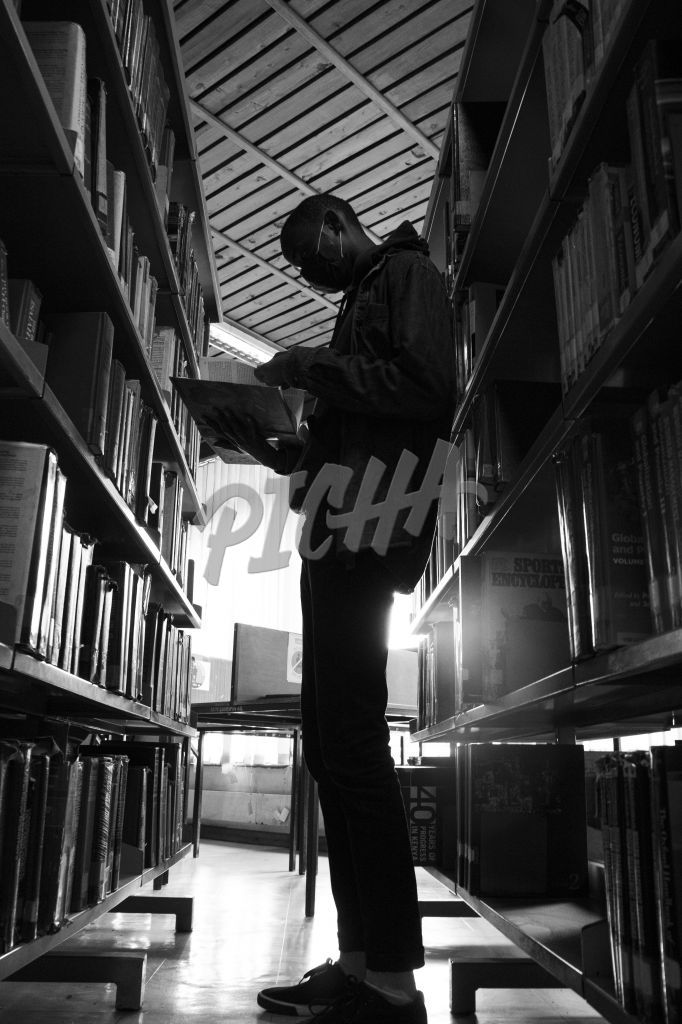 Man searching for a book in the library