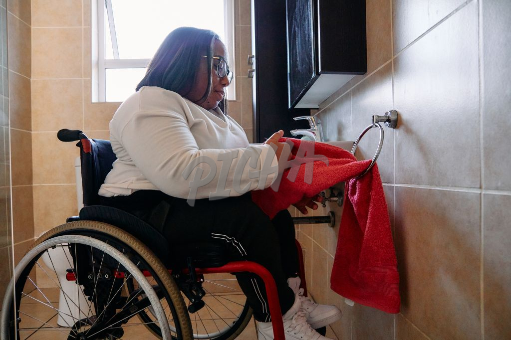 Young Woman in wheelchair drying hands