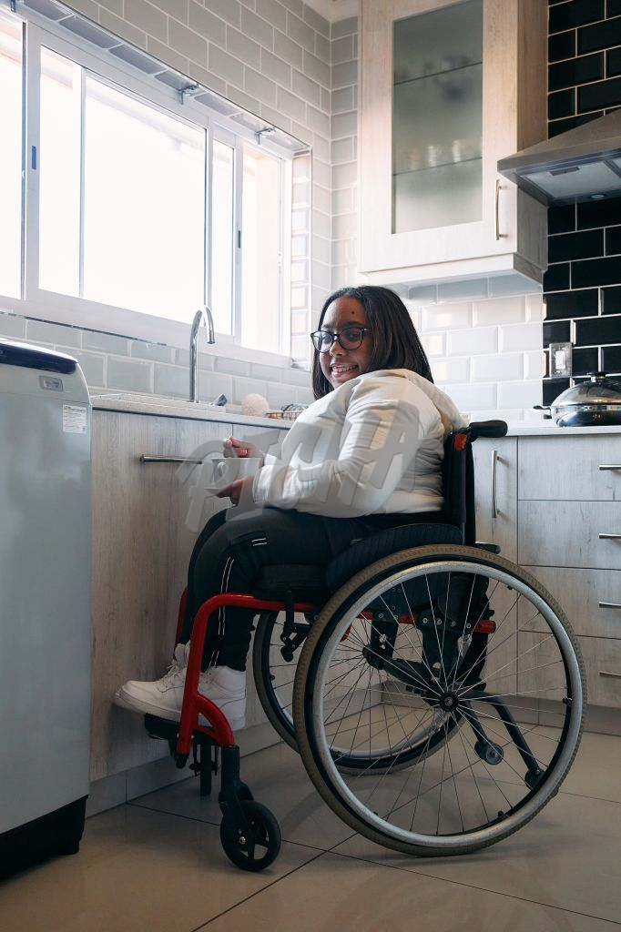 Woman in wheelchair holding a cup of tea