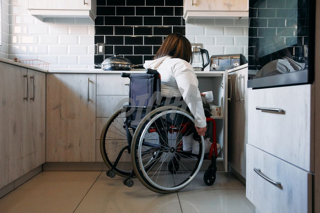 Young Woman with a disability in the kitchen