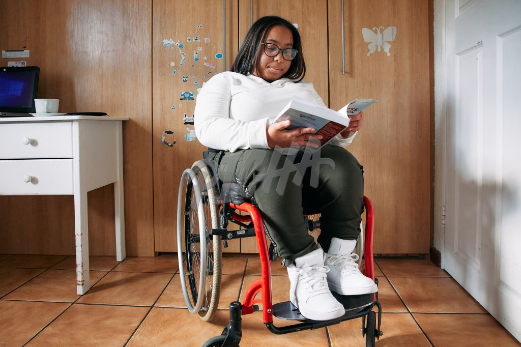 Young Woman with a disability loving her book
