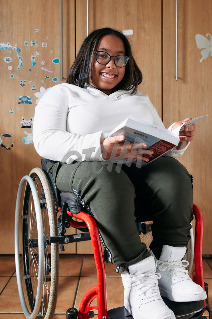 Young Woman with a disability reading a book