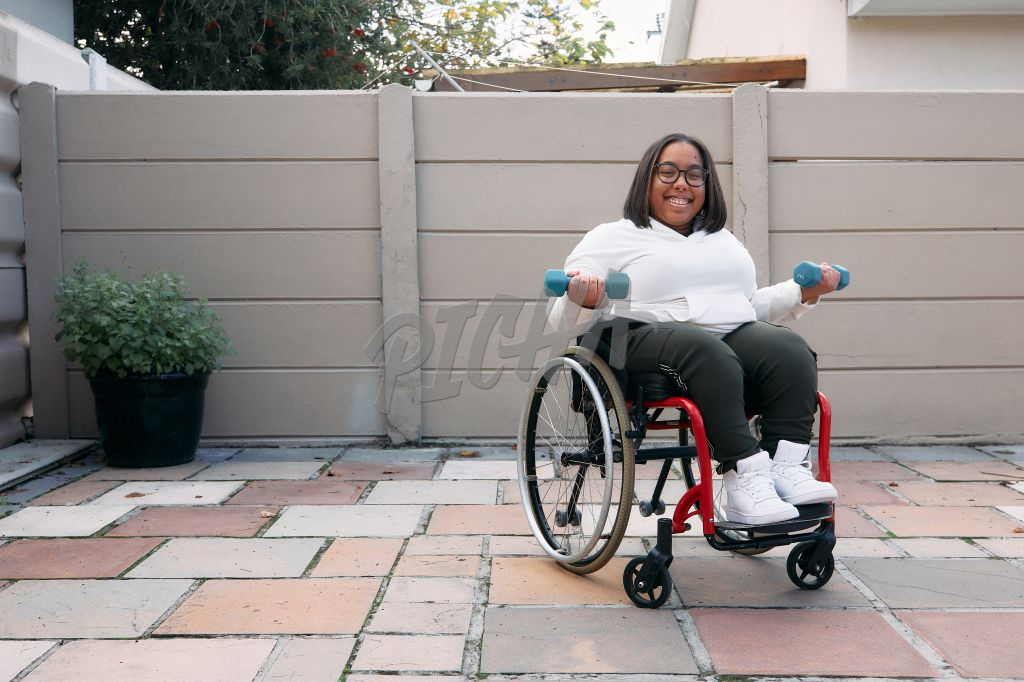 Young Woman on a wheelchair working out