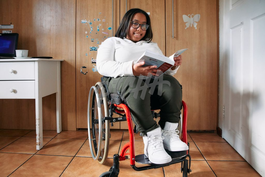 Young Woman with a disability reading calmly