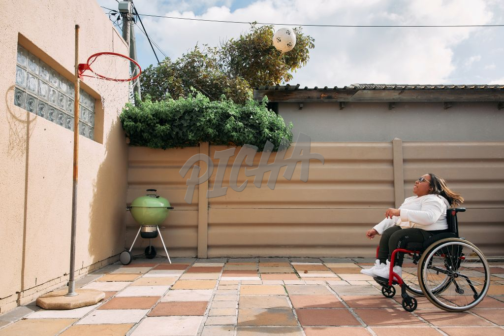 Young Woman with a disability playing basketball
