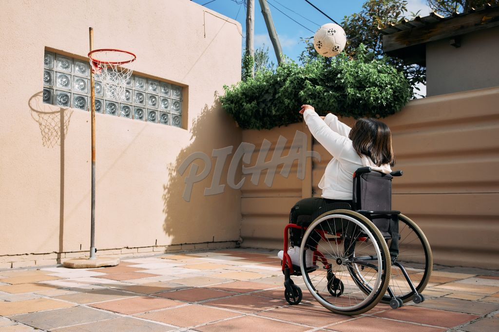 Young Woman with a disability playing with a sport