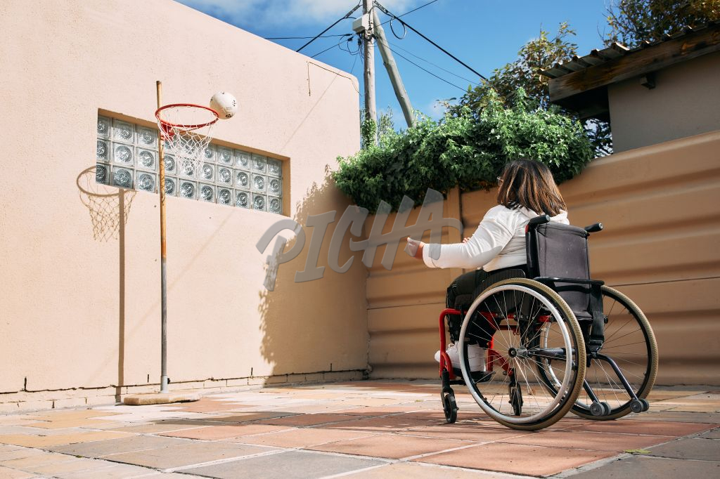 Young Woman with a disability playing outside