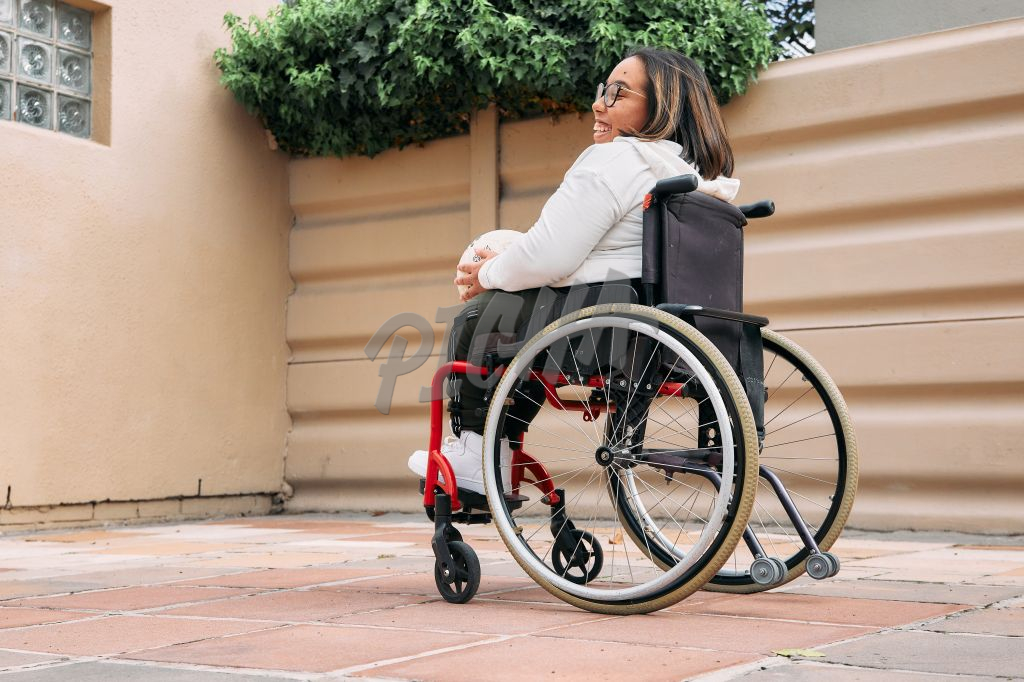 Young Woman with a disability in a wheelchair