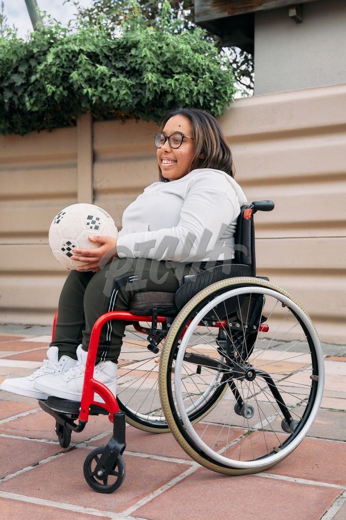 Young Woman with a disability using a ball