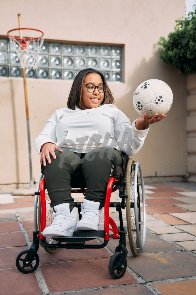 Young Woman with a disability holding a ball
