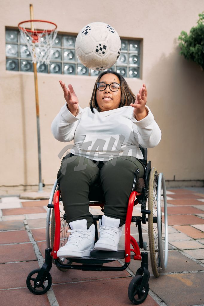 Young Woman with a disability playing with a ball
