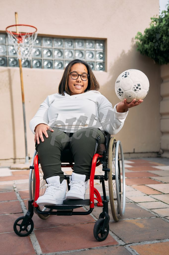 Young Woman with a disability smiling with a ball in her hand