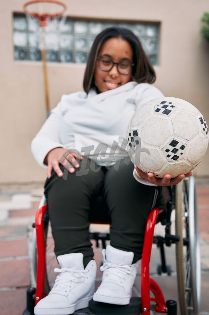 Young Woman with a disability smiling with a ball