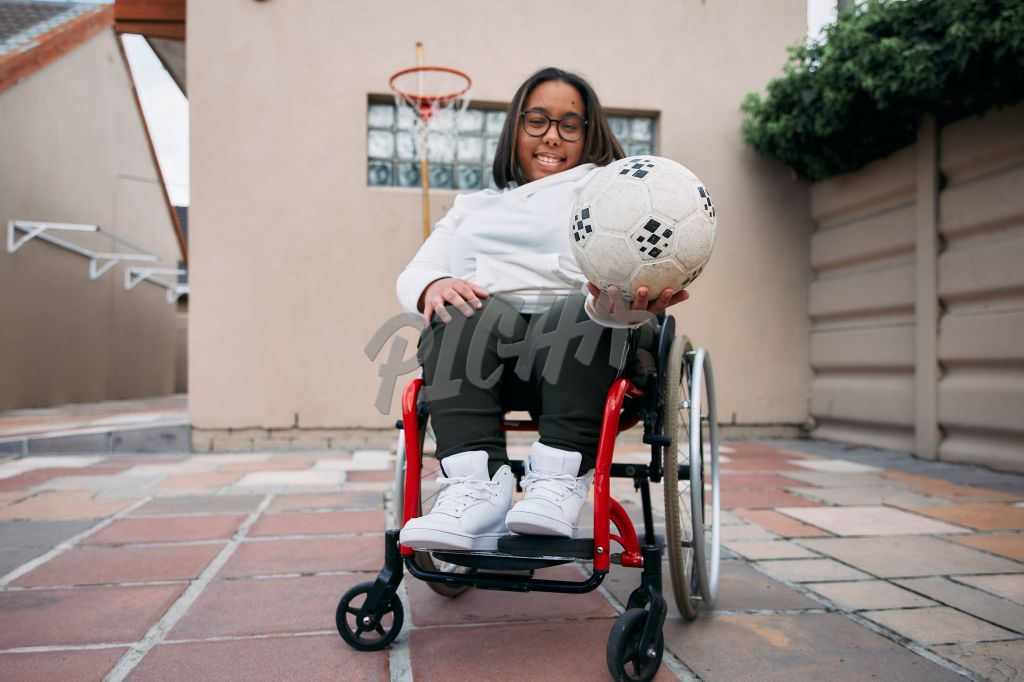 Young Woman with a disability in her wheelchair playing basketball