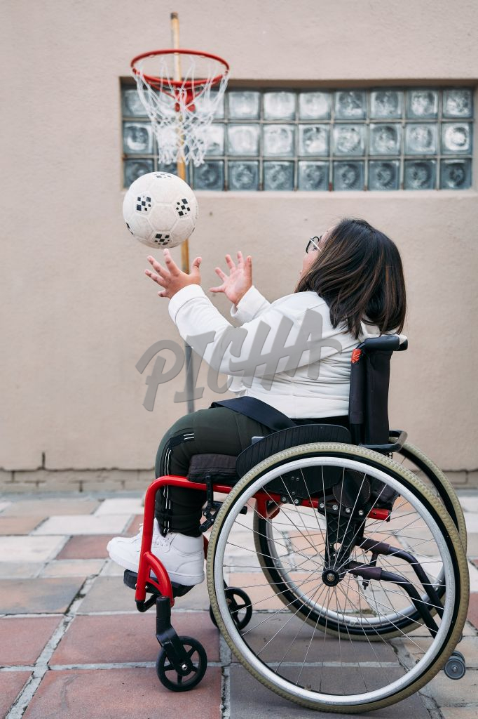 Young Woman with a disability catching a ball