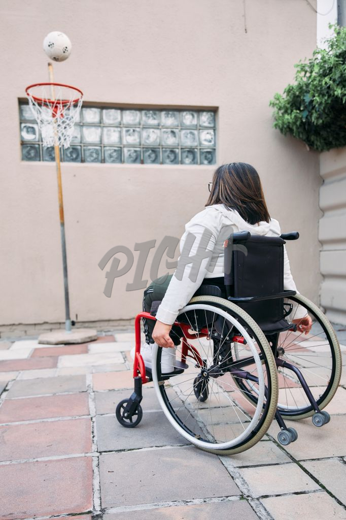 Young Woman with a disability playing outdoors
