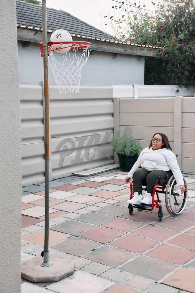 Young Woman with a disability on a basketball court