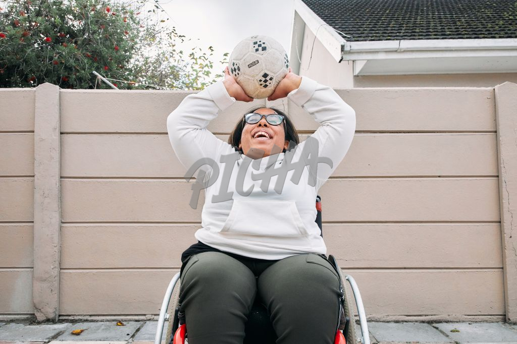 Young Woman with a disability throwing a ball