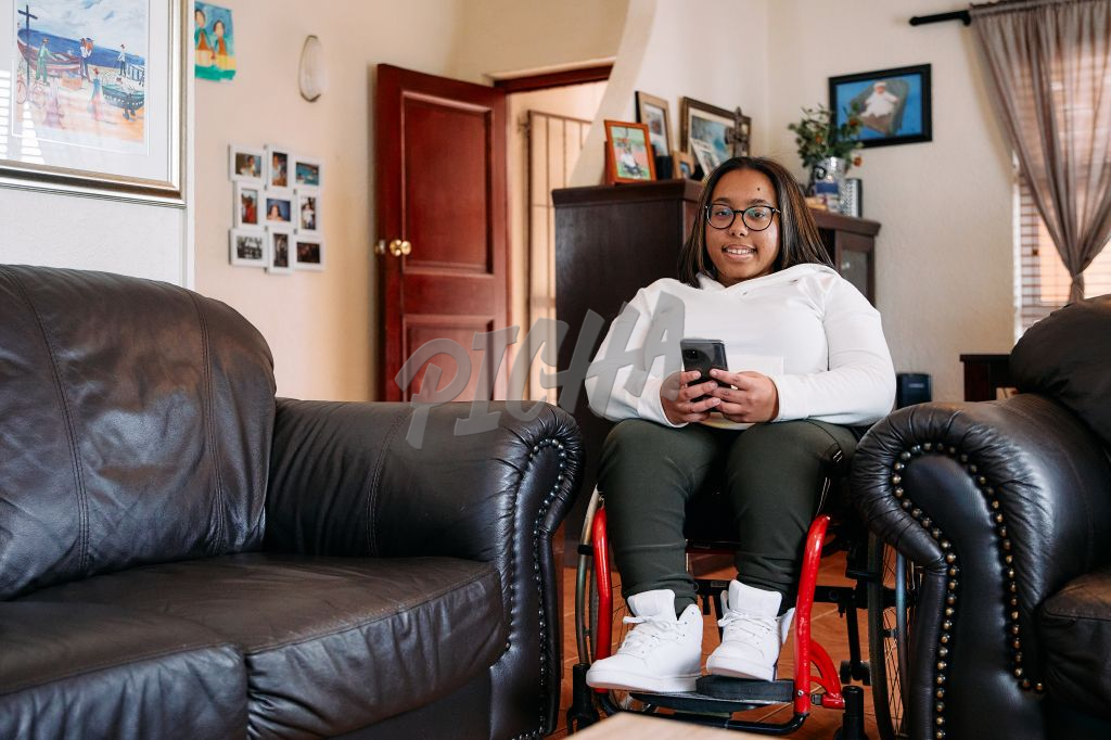 Young Woman with a disability on her phone