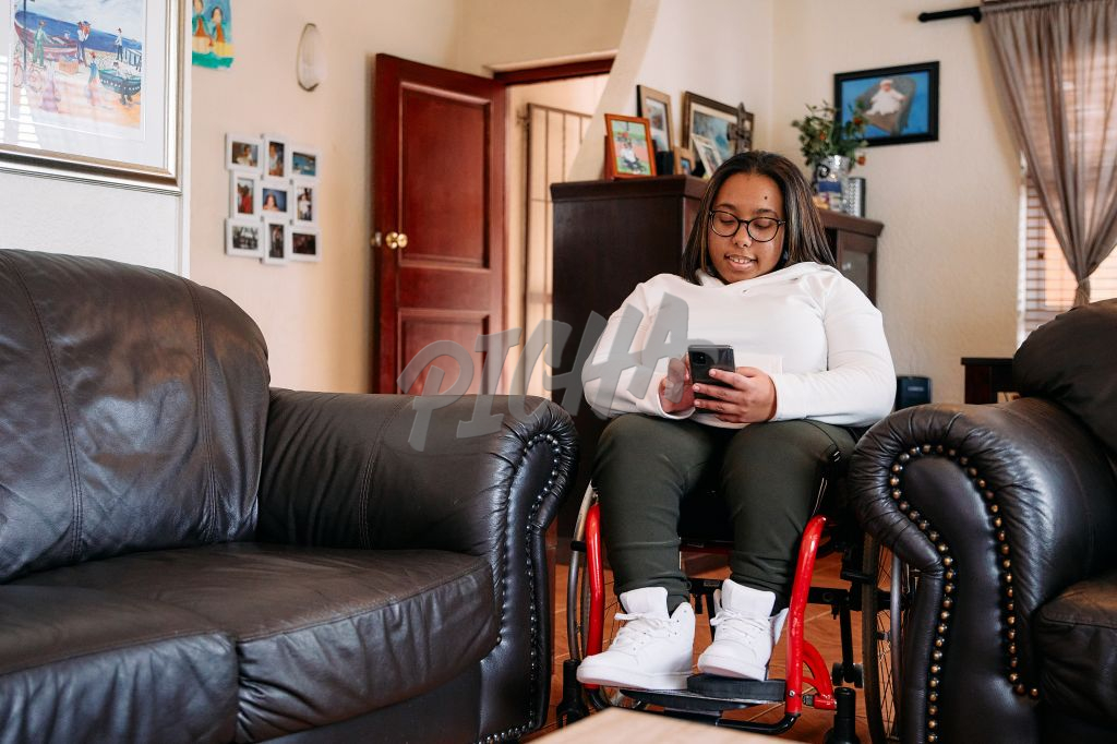 Young Woman with a disability in her living room