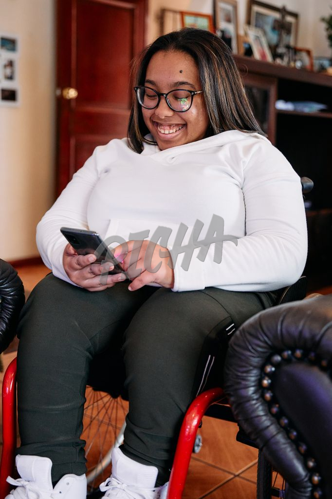 Young Woman with a disability smiling at home