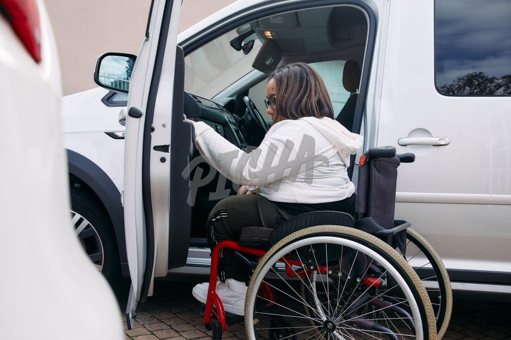 Young Woman with a disability getting into a car