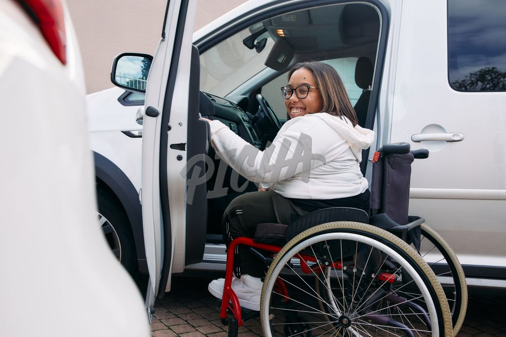 Young Woman with a disability driving into a car