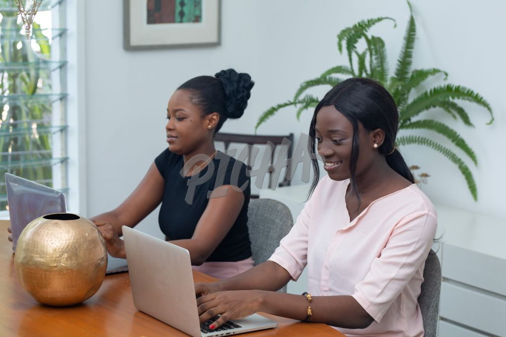 Two ladies share a workspace