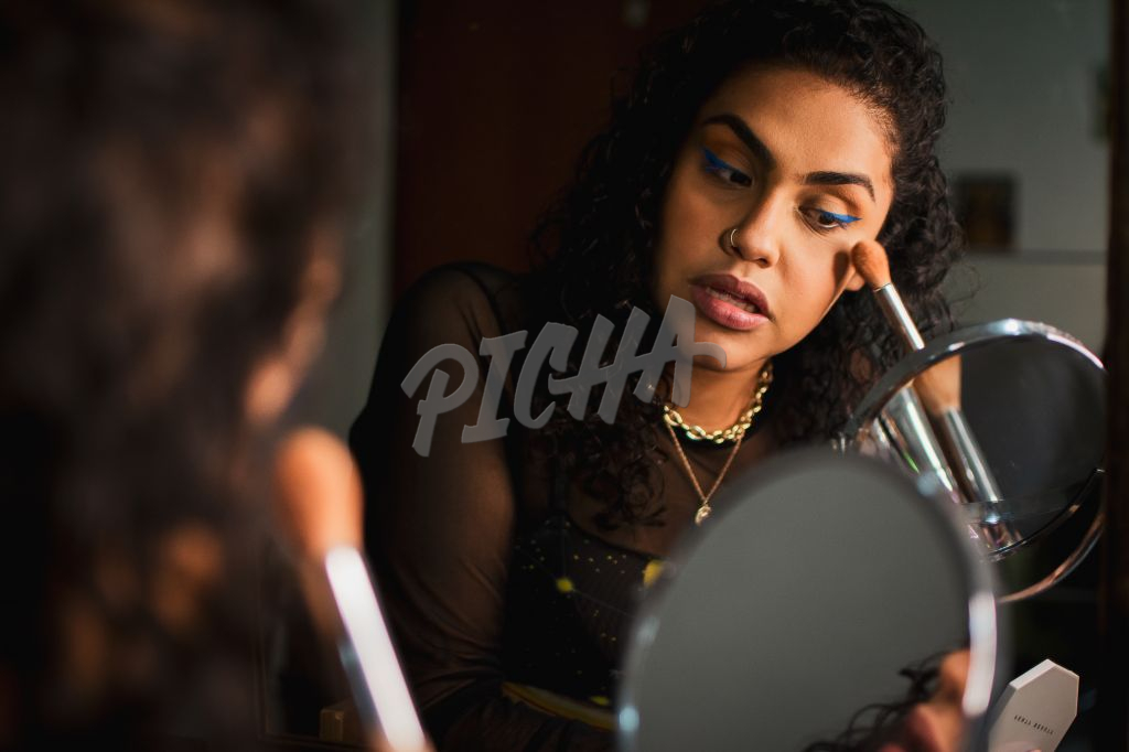 Lady touching up her face with makeup brush