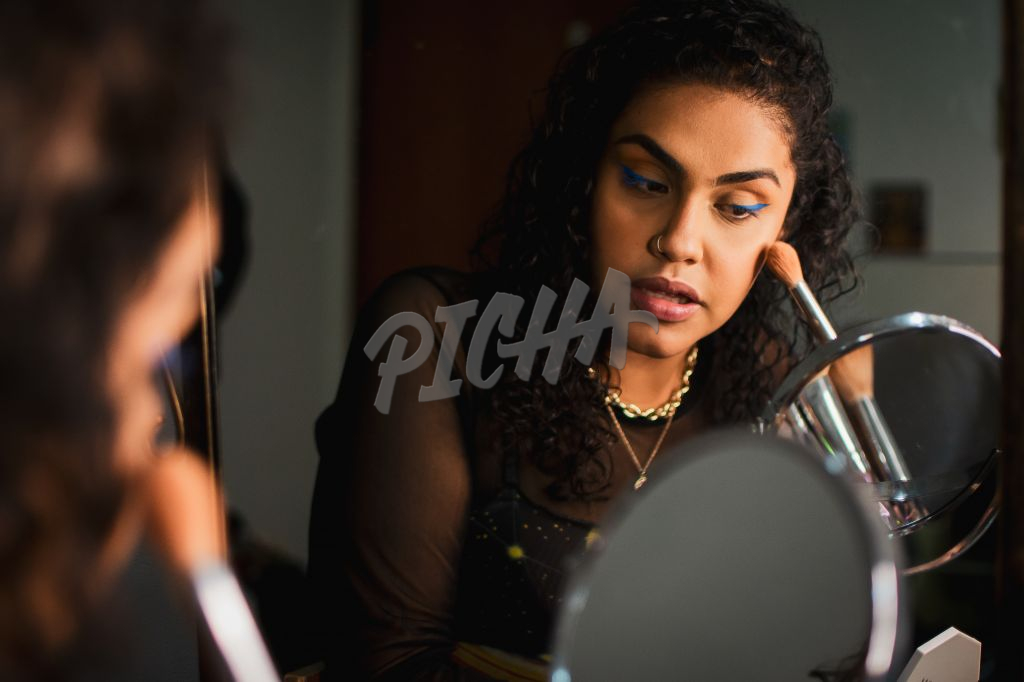 Young lady applying makeup
