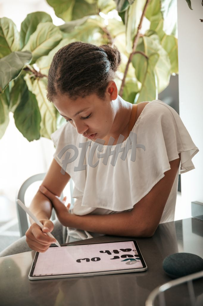 teenager using a tablet at home