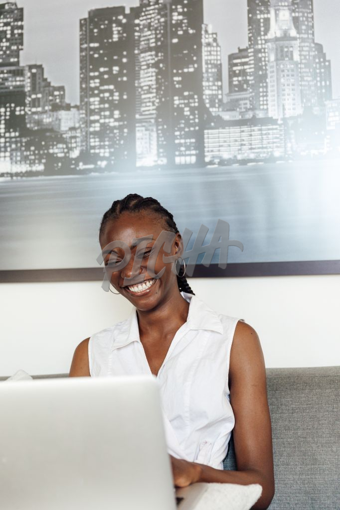 Woman laughing during a video call