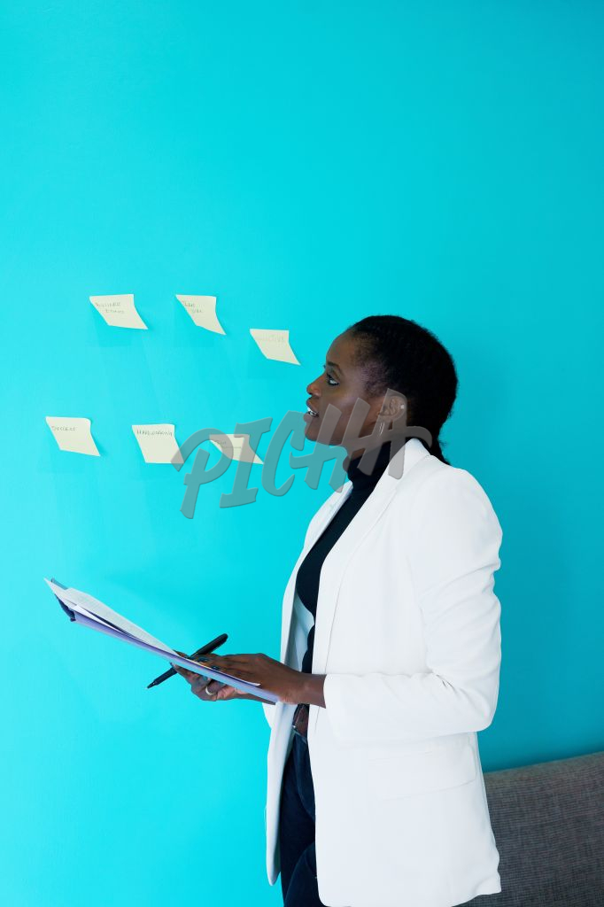 Lady looks through some sticky notes
