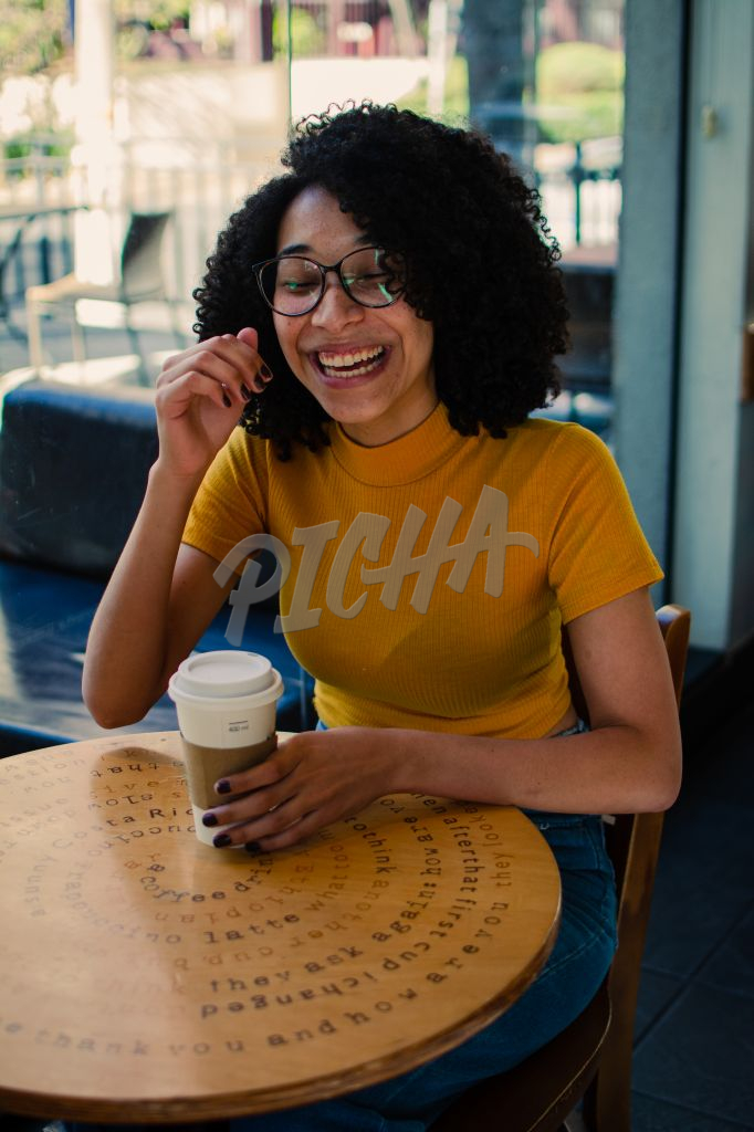 Girl at coffee shop laughing out loud