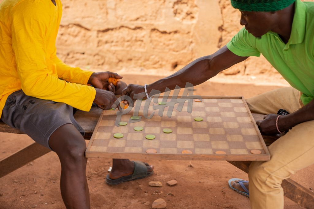 Friends playing checkers