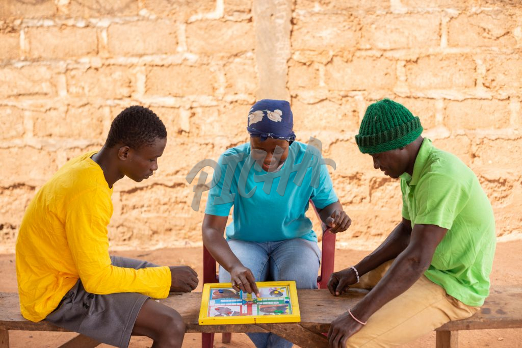 Friends playing ludo