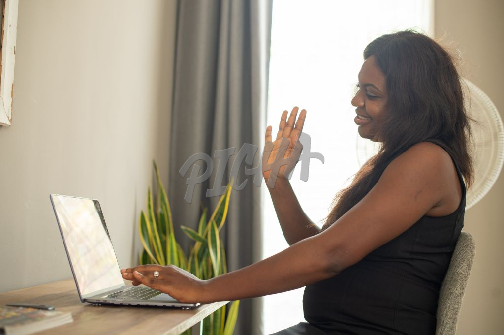 Woman waves during video chat