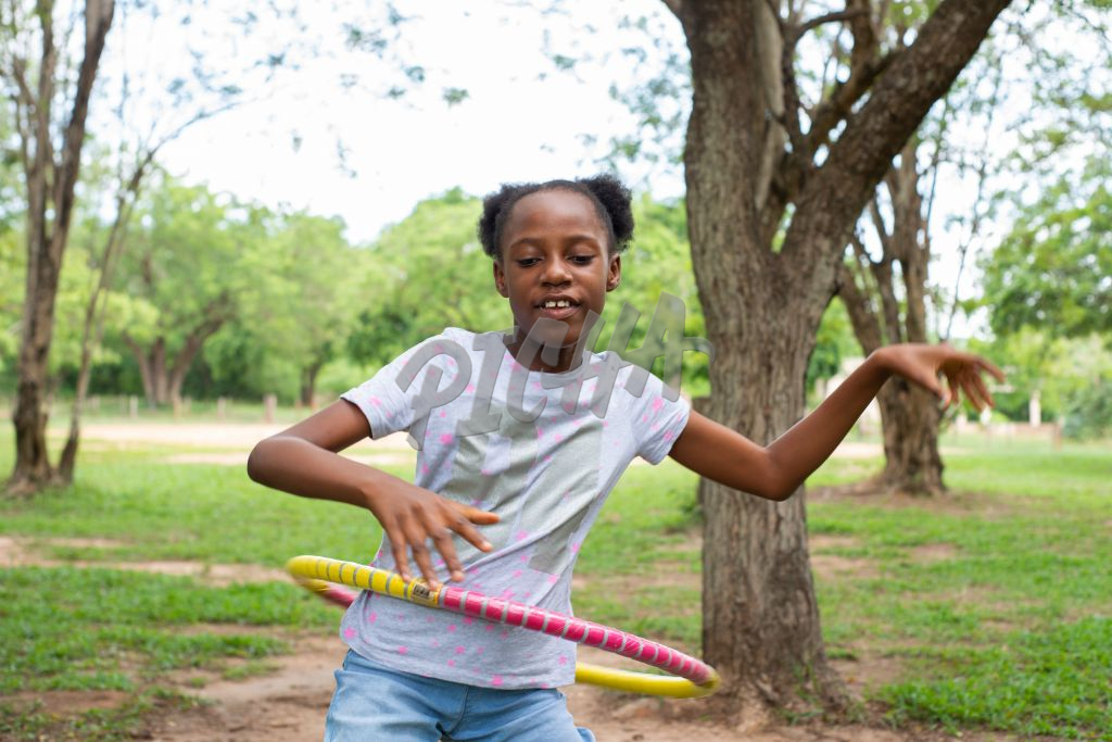 young girls playing with hula hoop