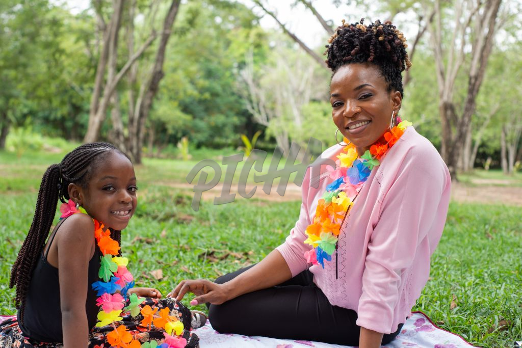 mother and daughter sitting in a park