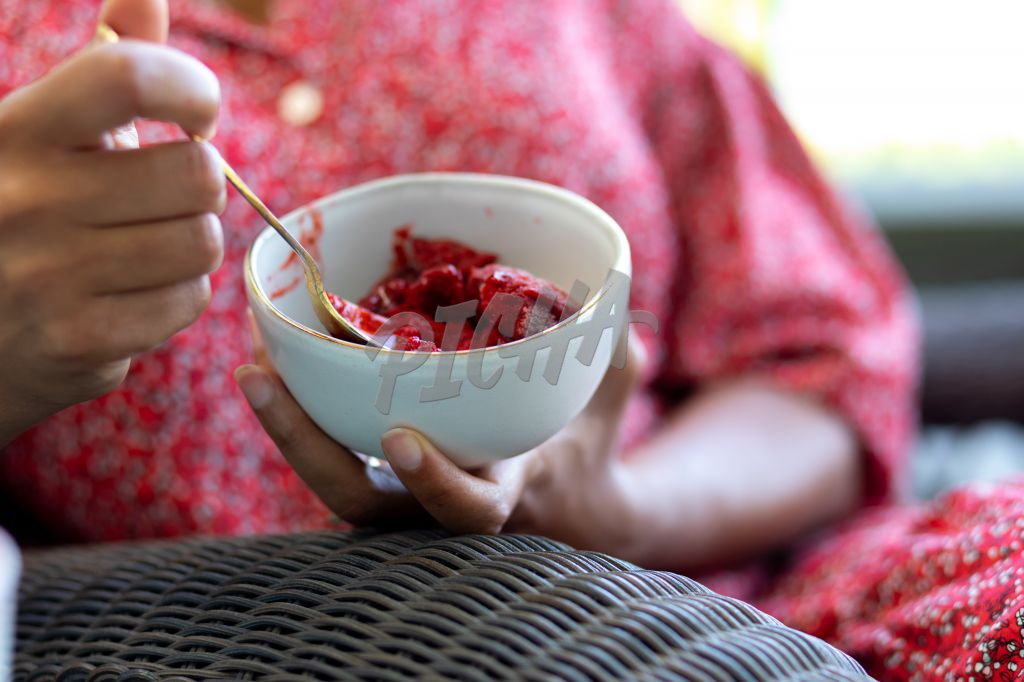 woman holding a bowl of sorbet