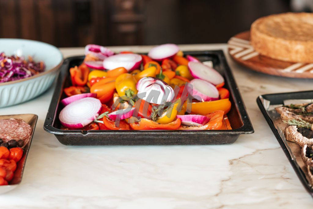 trays of vegetables ready to be grilled