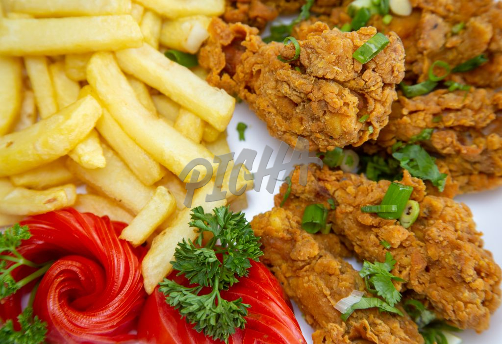 close up of fried chicken with french fries