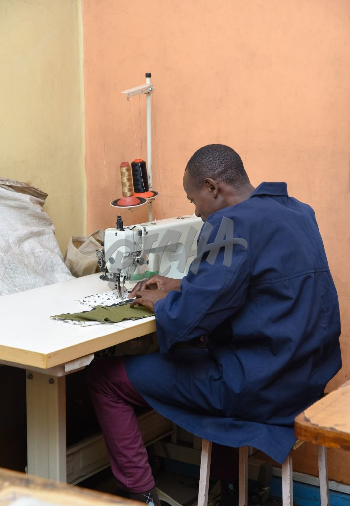 Man working on a sewing machine